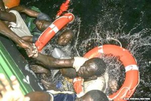 Migrants being recued from a sinking boat