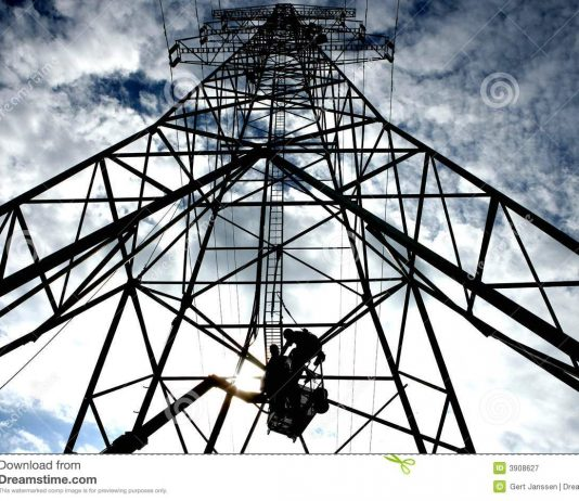 Electricity worker on a mast