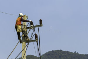 Electricity worker on pole installing new cable